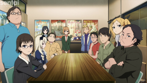 The cast of Shirobako looks toward the camera during an office meeting.