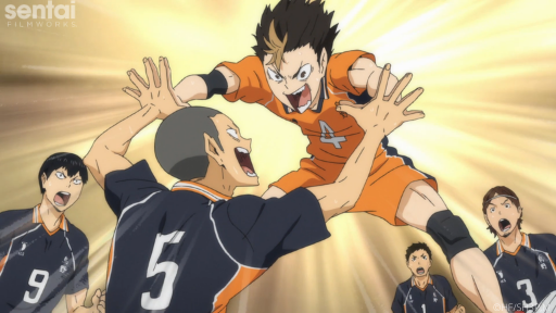 Ryunosuke and Yu celebrate by giving each other high fives.