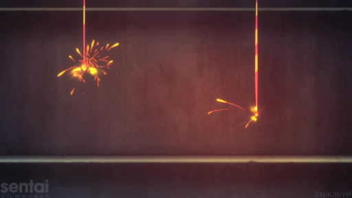 Two senko hanabi, or Japanese sparklers, burn shoot off sparks in front of a concrete staircase.
