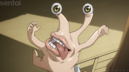Migi from Parasyte -the maxim- possesses the hand of Shinichi Izumi. The misshapen, seemingly now boneless hand now has tiny mini-hands on the forefinger and pinkie, a mouth (complete with a full set of teeth and a lolling tongue) in the center of the back of the hand, and two eyeballs on the tips of the middle and ring fingers.