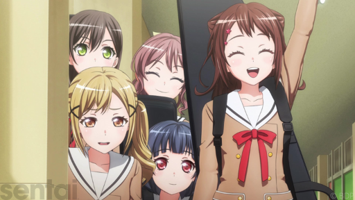 Kasumi from BanG Dream! holds one hand aloft, grinning. Her friends stand behind her, looking more subdued. They all wear the same brown school uniform with a red ribbon on the collar.