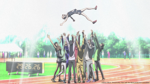 The entire team from Run with the Wind celebrates Prince's accomplishment by throwing him up in the air.